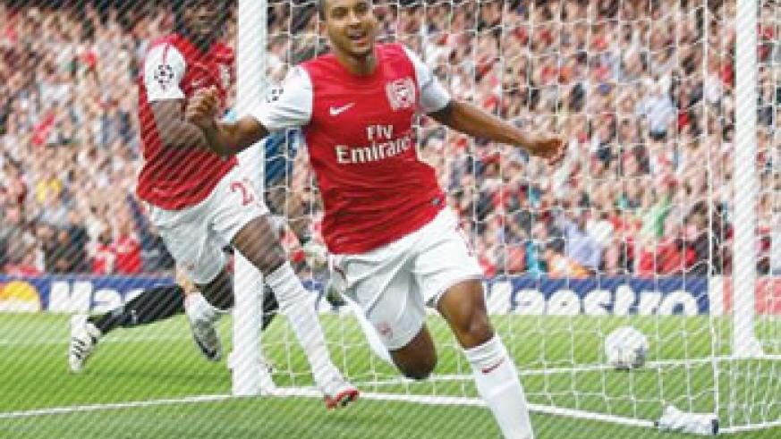 Theo Walcott celebrating after scoring aganist Udinese.  The New Times / file.