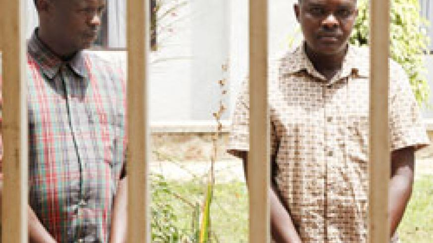 The attempted murder suspects Bernard Africa (L) and Theoneste Uwamahoro(R) are paraded at Kigali's Remera Police station yesterday. The New Times /Timothy Kisambira