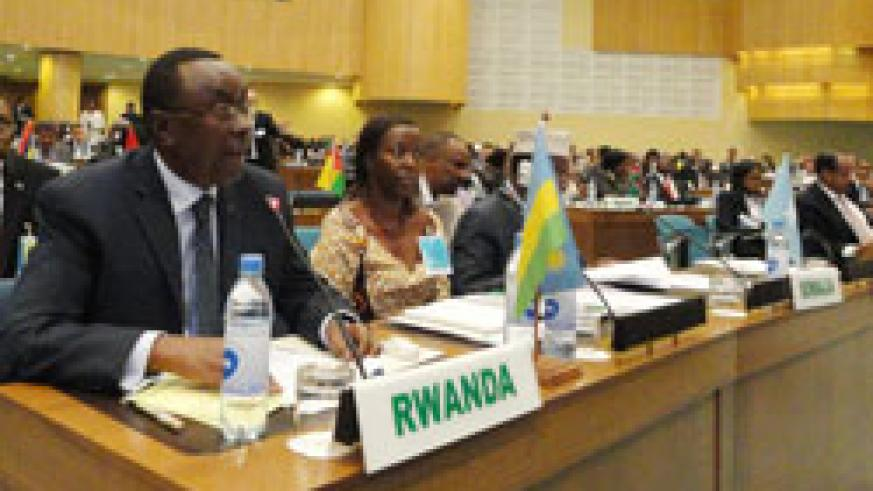 Premier Makuza and  Foreign Affairs Minister, Louise Mushikiwabo (R) at the AU pledging conference, yesterday. The New Times/Courtesy