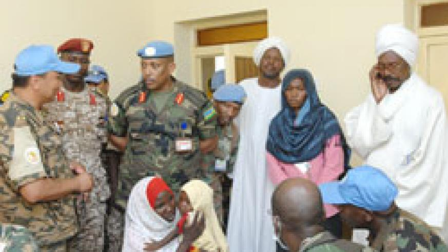 UNAMID Force Commander Lt. Gen Patrick Nyamvumba (Third Left) in discusions with officials during the seven-day medical campaign in North Darfur The New Times /File