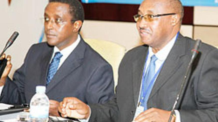 Senate President Dr Vincent Biruta (L) and Cabinet Affairs Minister Protais Musoni  at the opening of the media and gender conference yesterday. The New Times /Timothy Kisambira.
