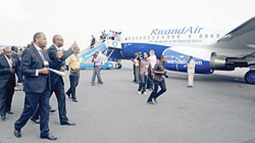 Minister of Infrastructure, Albert Nsengiyumva accompanied by John Mirenge, RwandaAir's CEO, steps forward to inspect the newly acquired  Boeing 737- 800 NB aircraft, on saturday. The New Times / File photo