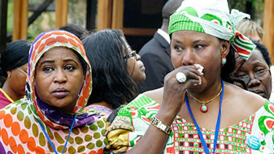 Women who attended the African Journalists' conference get emotional during their visit to Kigali Genocide memorial. The New Times/courtesy photo