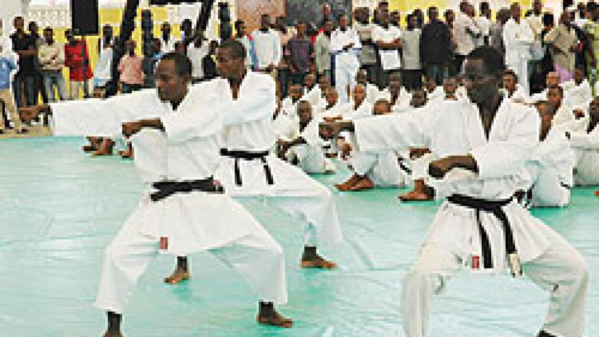 Vincent Munyeshaka [C] leads team mates  in a Kata demostration during a recent tourney in Kigali. The team targets to win medals in Maputo. The New Times / File photo