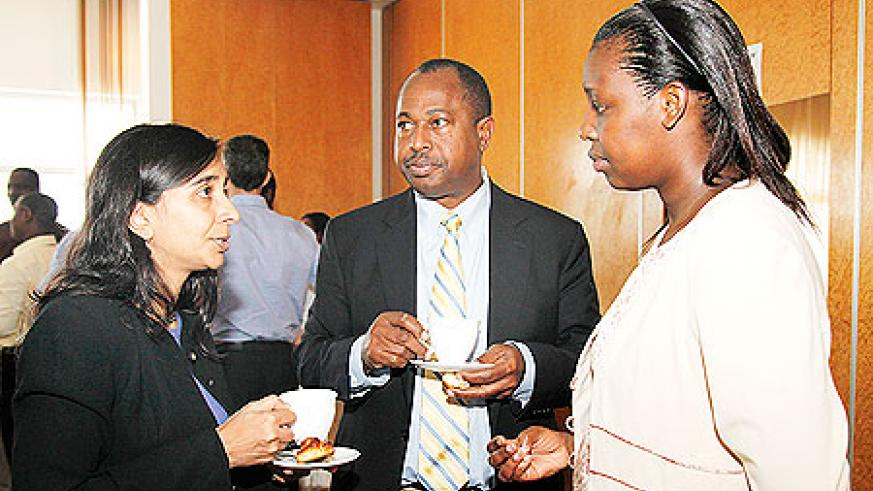 Pratima Raghunathan, the Country Director of CDC (L), Denis Tindyebwa, a Tanzanian expert in Pediatrics and HIV treatment of children, and Dr. Anita Asiimwe, from the Rwanda Biomedical Centre during the meeting yesterday. The New Times /Timothy Kisambira.