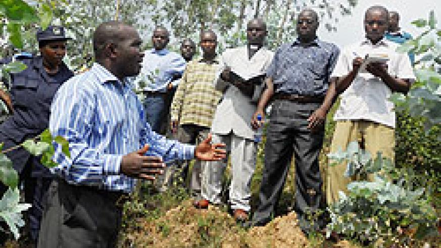 Local authorities inspect one of the areas where forests have been planted. The New Times Bonny Mukombozi.