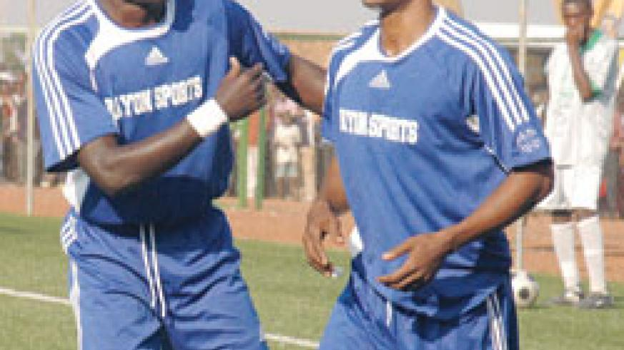 GOOD TIMES: Labama Bokota (right) celebtates with team mate Bonaventure Hategekimana (L) after scoring during the 2008 Peace Cup semifinal against Atraco. The New Times / File