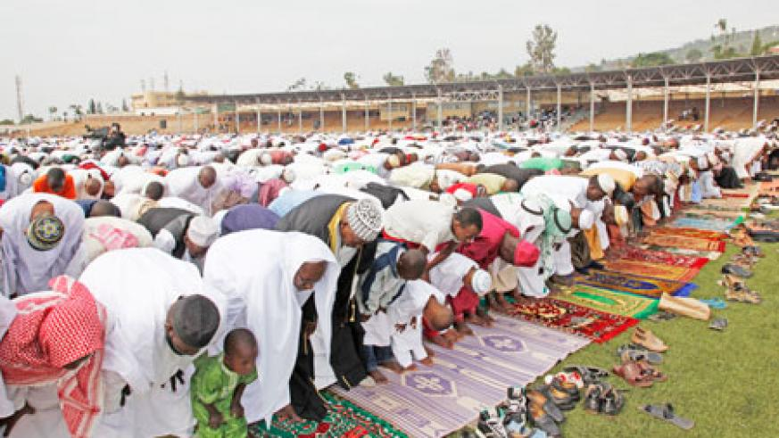 Thousands of Muslims thronged Nyamirambo Regional Stadium for the Eid El-Fitr prayers, yesterday. The New Times/Timothy Kisambira.