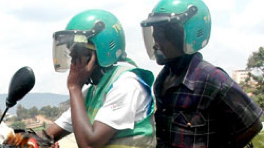 A new disposible material will be inserted inside helmets to protect taxi moto passengers from contracting disease. The New Times /Timothy Kisambira.