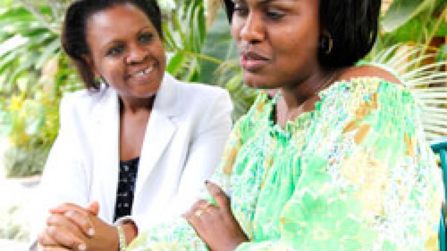 The General Manager of CIAR Africa Ruth Kwalanda (L) converses with the president of the HR managers' association in Rwanda Alice Mugeni. The New Times /Timothy Kisambira