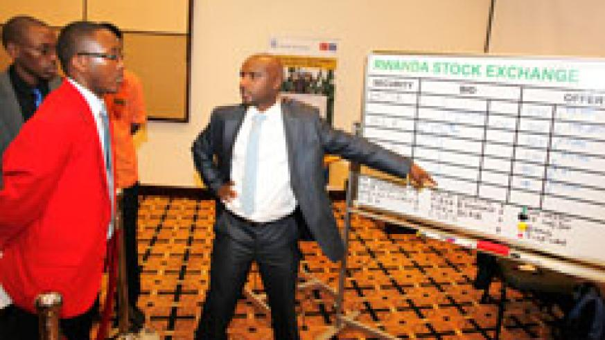 Stockbrokers at the RSE. Investors have expressed a high appetite for shares of domestic companies The New Times /T. Kisambira