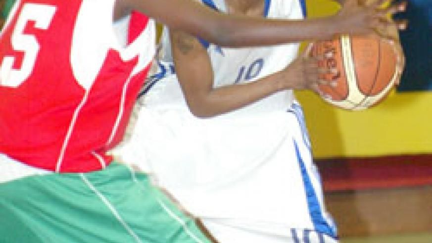 Honoré Ayebare, seen here on the right against Burundi during the zone V tourney, contributed 12 points for the ladies hoops. The New Times/File.