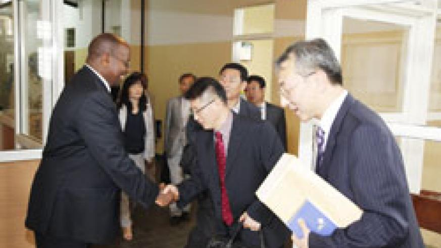 Local Government Minister James Musoni receives the Korean delegation at his offices this week. The Koreans will build a model village in Burera. The New Times /File