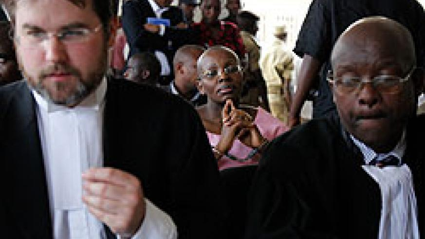 ( L-R) Lain Edwards, Ingabire Victoire (in the rear) and Gatera Gashabana in court yesterday.The New Times /Timothy Kisambira