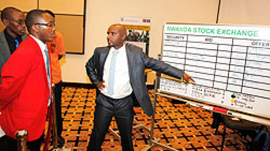 Stockbrokers at the RSE. Investors have expressed high appetite for shares of domestic companies. The New Times/ T. Kisambira