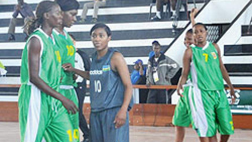Rwanda's Honore Ayebare (centre in black) reacts to play during the yesterday game against Mali, a game Rwanda lost 59-62. The New Times/Courtsey