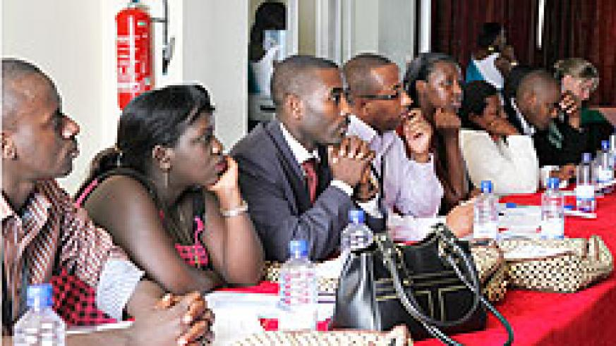 Participants listen to a presentation during the mental health conference in Kigali. The New Times/ Timothy Kisambira