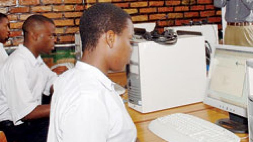 Students in a computer lab; Government's plan to distribute computers in all schools is set to enhance student's competitiveness. The New Times /File.