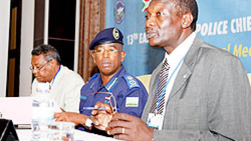 (L-R)Maj. Gen. Babeker Sumara, the Chairperson of the Permanent Coordinating Committee of the Police Chiefs Cooperation, Deputy Inspector General of Police, Stanley Nsabimana, and Dahia Awad, the head of regional bureau, (EAPCCO) during the regional Polic