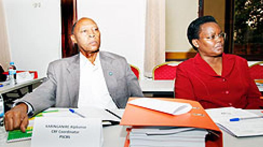 Alphonse Kalinganire, the Capacity Building Fund Coordinator (L) together with Angelina Muganza, Executive Secretary of Public Service Commission. The New Times /Timothy Kisambira