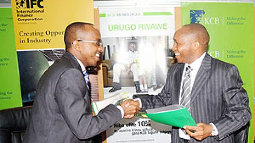 L-R; Kariuki Thande, Senior investment officer with IFC, KCB Rwanda Managing Director Maurice Toroitich and Chief Business officer with KCB James Agin during the signing of a loan agreement worth US$5m in Kigali yesterday