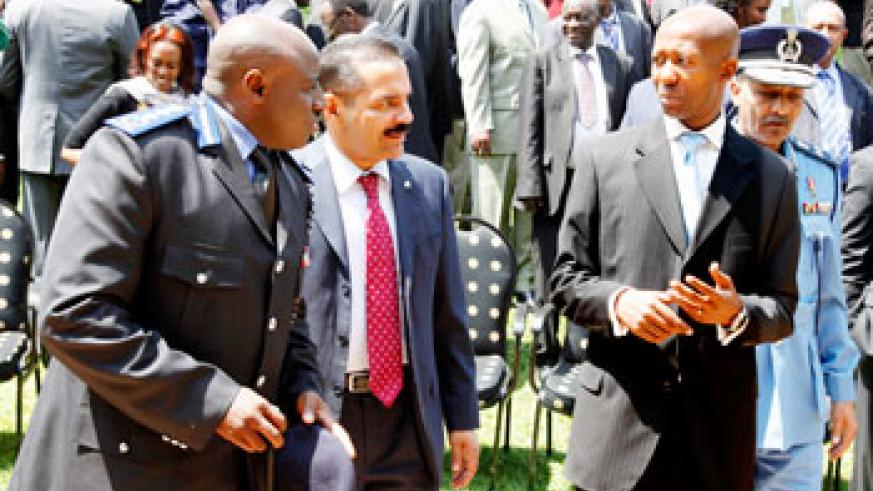 (L-R) Inspector General of Police Emmanuel Gasana, Ronald K Noble the Executive Secretary of Interpol and Internal Security minister Musa Fazil Harelimana during the opening of the regional police chiefs meeting in Kigali yesterday. The New Times /Timothy