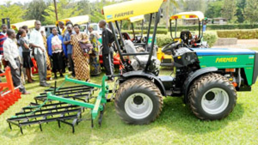 Local farmers examine modern agricultural machines at this year's agriculture exhibition. Local farmers will benefit from the regional market. The New Time /File photo