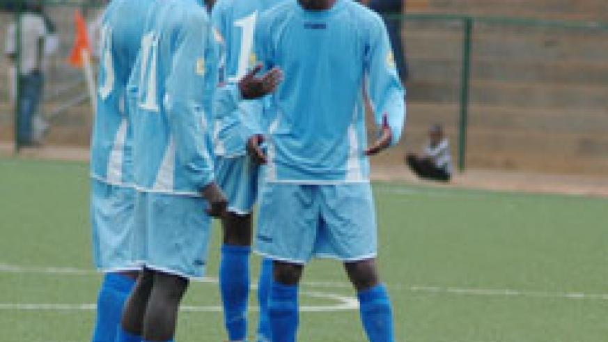 Rayon Sports players sharing ideas during a league match. The New Times / File