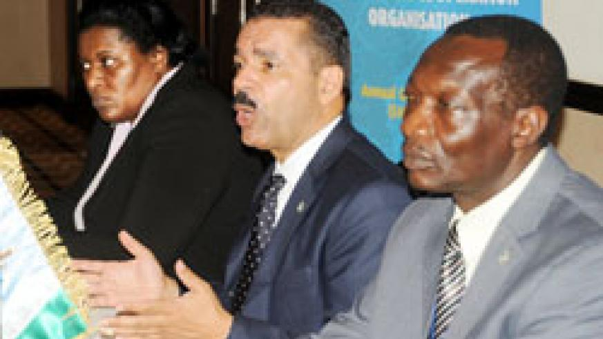 Interpol Chief Ronald Noble (C) franked by Elizabeth Kutesa(L) and Awad Dahia addressing the press yesterday. The New Times /John Mbanda.
