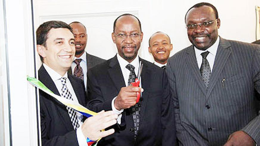 L-R Rwanda's Honorary Consul to Turkey Inanc Cifti, RDB's John Gara and Minister Francois Kanimba unveil the RDB office in Istanbul yesterday. The New Times /Courtesy.