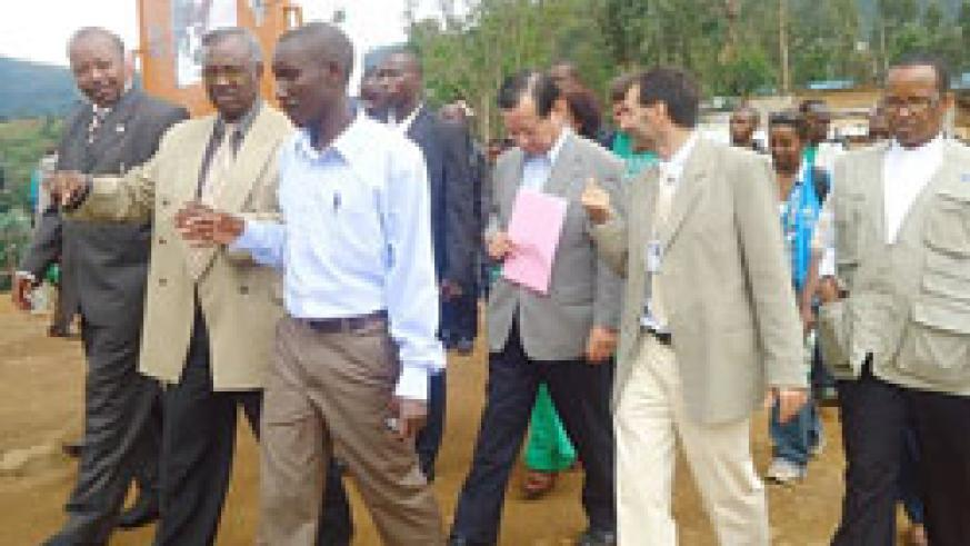 Minister Marcel Gatsinzi (2nd left) and other officials touring  Kiziba Refugee Camp. The New Times / Eric Kabera.