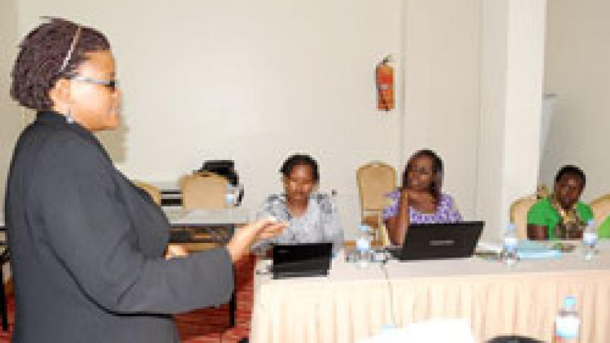 Nivatiti Nandujja, representing EASSI, addresses Journalists during the conference on Gender and Governance in East Africa in yesterday. The New Times /John Mbanda.