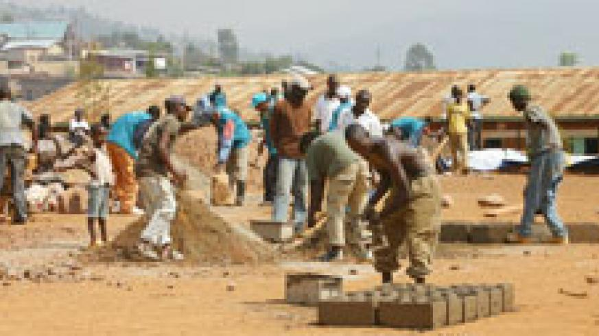 Residents prepare bricks for the construction of 9YBE classrooms. Their participation will again be required for the 12BE classes. The New Times /File.