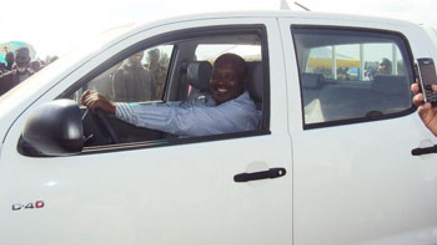 Hard work is rewarding. Apollo Rutagarama in his brand new vehicle donated by the President. The New Times/  File.