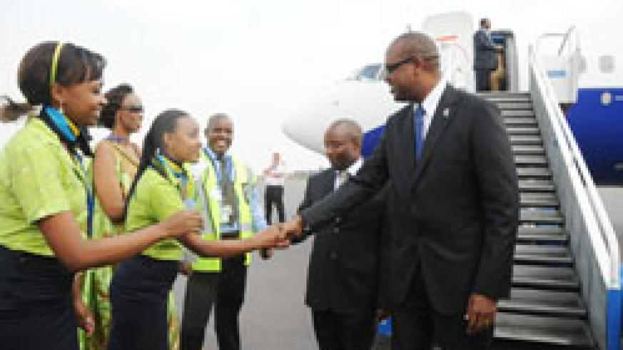 RwandAir CEO, John Mirenge, greets the airline's crew at the recent inauguration of the carrier's new Boeing. The New Times/ File.