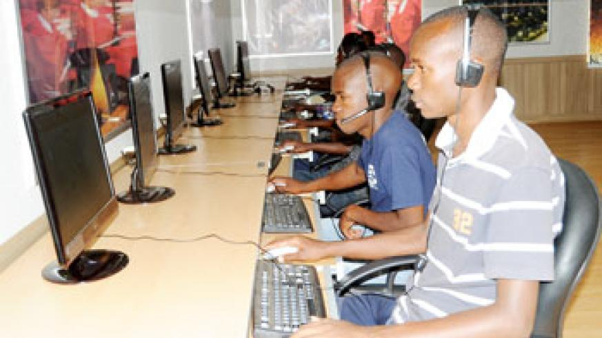 Students carrying out their research via internet. The New Times / J.Mbanda