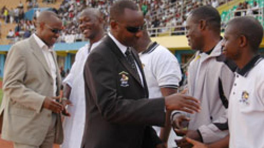 APR president Alex Kagame shakes hands with the APR bench ahead of a league match. /File