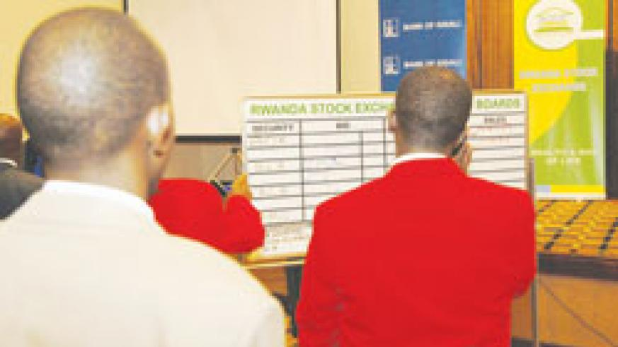 Stockbrokers at the RSE trading floor The New Times File .