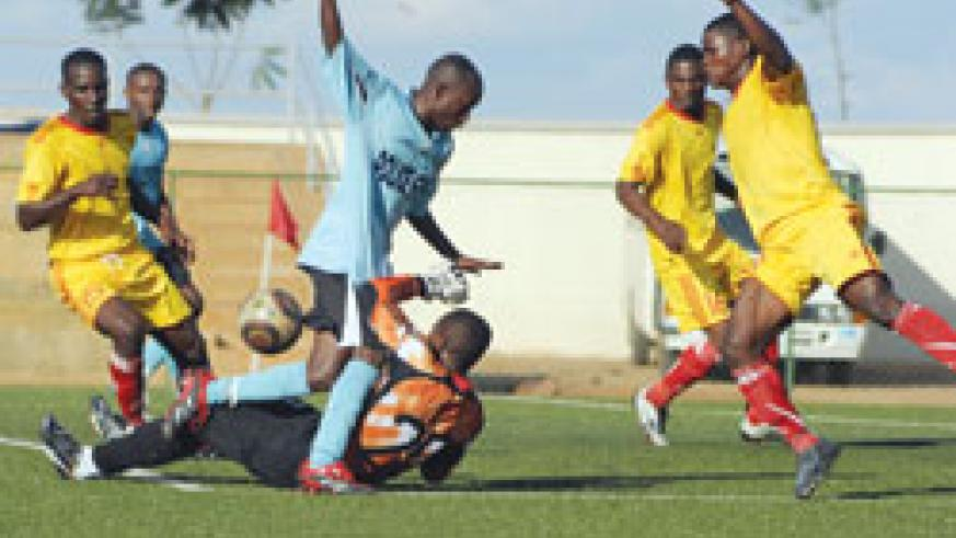 Police's Meddie Kagere fights for the ball with Etincelles goalkeeper during last season's Primus League. The New Times / File