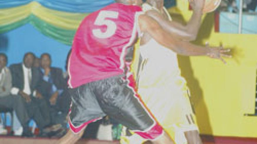 Fiston Muhire (with the ball) was overlooked for last month's Afrobasket tournament in Madagascar. The New Times / File.