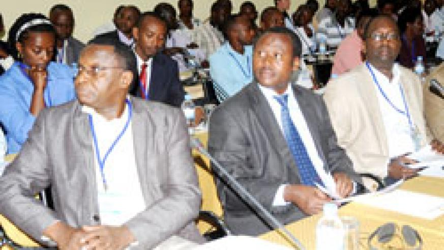 Health ministry PS Dr. Uzziel Ndagijimana (C) and other participants follow a presentation during a past performance based financing meeting. The New Times /File.