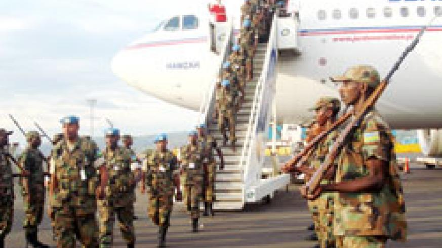 RDF Soldiers return from a peace keeping mission. RDF will soon embark on documention of peacekeeping experiences within its ranks. The New Times /File.
