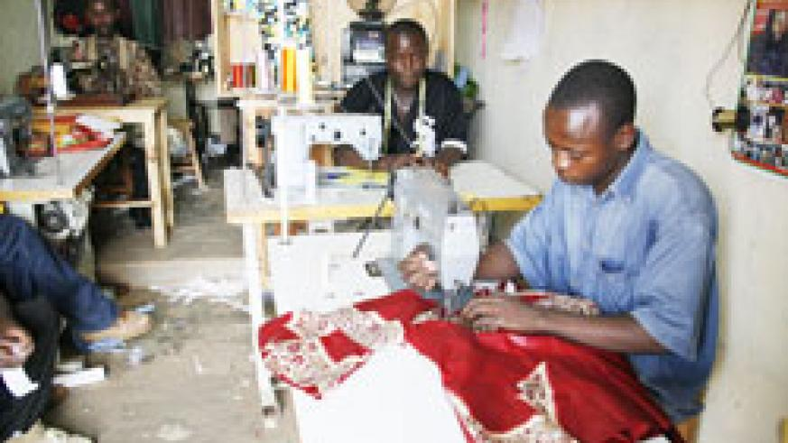 Workers in a tailoring workshop in Kigali. SMEs stand to benefit from the Guarantee Fund initiated by the Business Development Fund. The New Times / File.