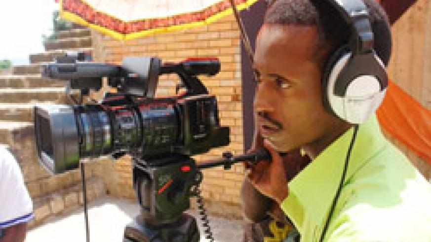 A Rwandan filmmaker demonstrates the workings of acamera during yesterday's opening of the Kwetu Film Institute in Kigali. The New Times / Courtesy.