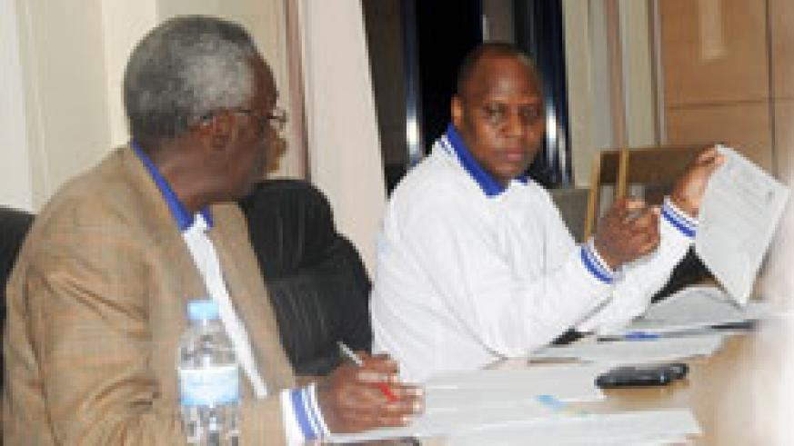 The NEC chairman, Prof. Chrysologue Karangwa,  (L) during the release of the senate elections outcome yesterday