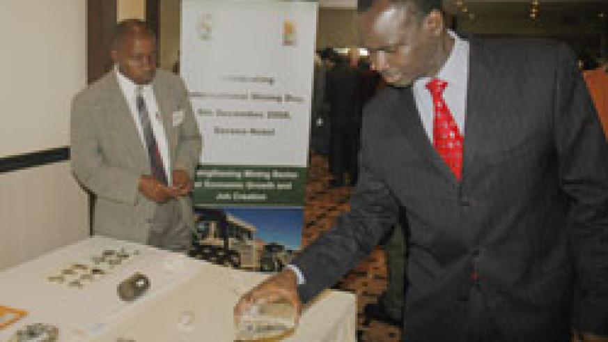 Natural resources Minister Stanilas Kamanzi examines stones mined in Rwanda. A mining giant has expressed interest in Rwandan gold. The New Times /File.