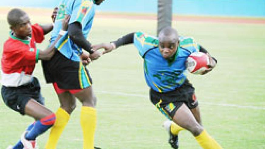 Silverbacks' fullback Vincent Kamali side-steps a Burundian opponent during last year's CAR15s final. He is one of Rwanda's key players. The New Times/File.