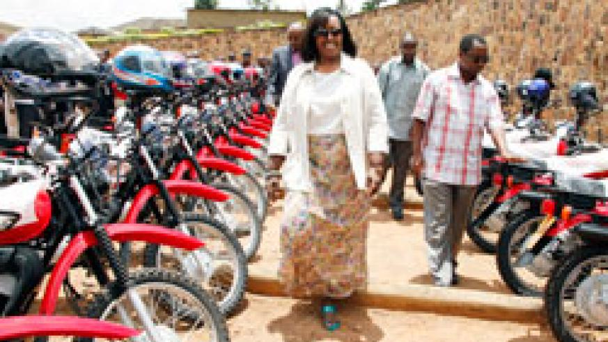 The Minister of Health, Agnes Binagwaho inspecting the new motorcycles. The New Times / Timothy Kisambira