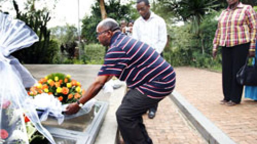 Augustino Nanyaro the Principal Commissioner of Tanzania Prison Service lays a wreath at the Gisozi memorial yesterday. The New Times /Timothy Kisambira.