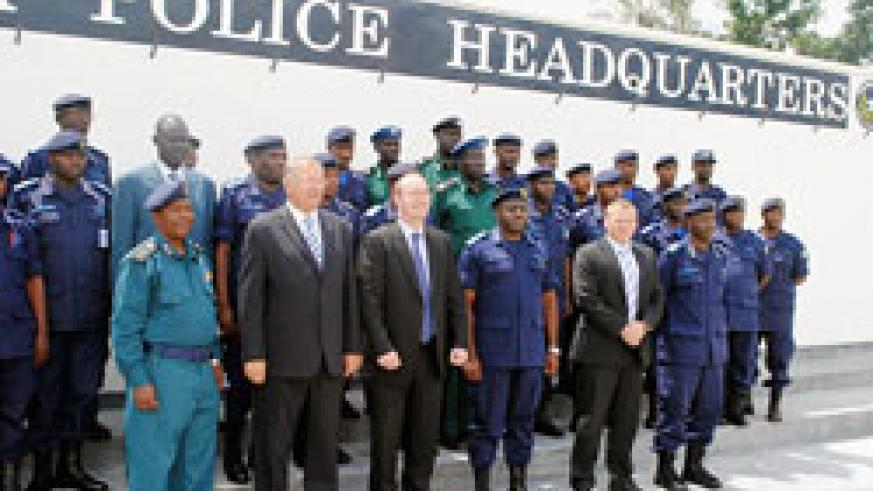 IGP Emmanuel Gasana and the British Envoy Llewellyn Jones in a group photo with police trainees yesterday. The New Times /Courtesy.